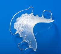 orthodontic teeth retainer brace bracket - stock photo