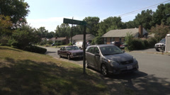 Quiet neighborhood street and parked cars Stock Footage