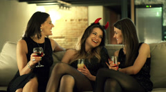 Three young woman sitting on the sofa and having fun at the bachelorette party Stock Footage