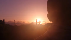 Young adult silhouette, Hazy sunset Stock Footage