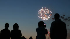 Blurred silhouettes of people watching fireworks Stock Footage