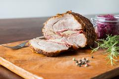 Spit roast with red cabbage Stock Photos