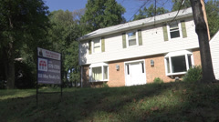 Modest house with for sale sign out front Stock Footage