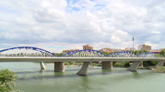 Clouds and iron bridge over river Ebro - traffic Stock Footage