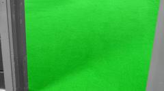 Door closes green floor behind - stock footage