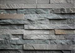 Slab of dark stone arranged style in interior. Stock Photos