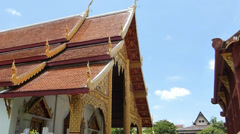 Beautiful architecture of temple roofs, gables against blue sky, Chiang Mai Stock Footage