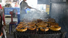 A stall selling Sai Oua, a Northern Thailand grilled spicy sausage, Chiangmai Stock Footage