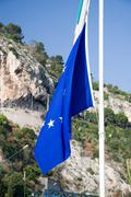 Flag of Europe on the flagstaff - stock photo
