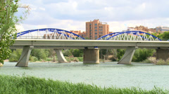 Iron bridge and cloudscape over river Ebro Stock Footage