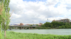 Time lapse on clouds and iron bridge over river Ebro Stock Footage