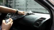 Stock Video Footage of The man washes the car inside (interior) - wiping with a cloth