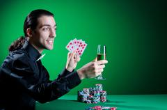 Stock Photo of Player in casino and chips