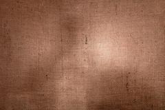 Hessian burlap backgound with uneven light Stock Photos