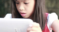 HD close up of girl playing touching tablet computer surface touchscreen ipad Stock Footage