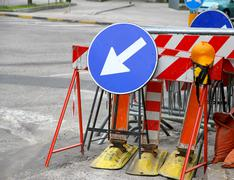 Road signs with a large arrow to identify the place of work in progress Stock Photos