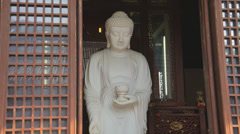Stone Buddha statue in Shanghai, China Stock Footage