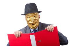 Espionage concept with masked man on white - stock photo