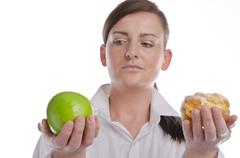 Stock Photo of woman with apfel and cake