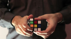 Solving Rubik Cube Puzzle  Warm Look - stock footage