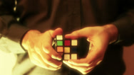 Stock Video Footage of Solving Rubik Cube Puzzle Glowing