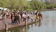 Stock Video Footage of Pan wide shot of people at waterfront in Shangahi, China