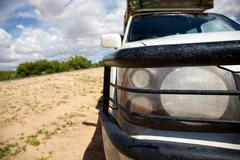Headlights and bumper of a 4x4 car - Kalahari Stock Photos