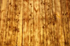 Wood background with yellow light - stock photo
