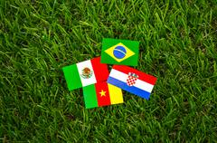 Paper cut of flags on grass for soccer championship 2014 , group a Stock Photos