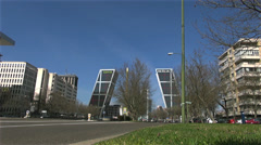 Cars ride by urban road near Gate to Europe complex,Madrid Stock Footage