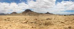 Surreal panorama of the Kaokoland game reserve in Namibia - stock photo