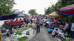People sell and buy vegetables in the market of urban village area in Chengdu - stock footage