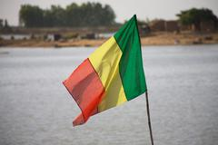 Mali Flag with the Niger - stock photo