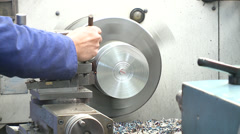 Stock Video Footage of Man working with lathe and modeling a iron piece