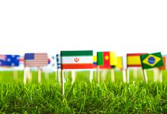 paper cut of flags on grass for soccer championship 2014 - stock photo