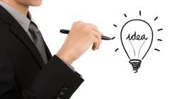 business man hand drawing light bulb isolated on white background - stock illustration