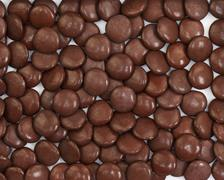 Dark brown dragee in chocolate covered. Stock Photos