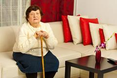 Senior woman in living room Stock Photos