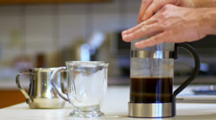 pouring coffee in a mug 4K - stock footage