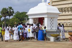 Buddhists praying at Anuradhapura in Sri Lanka - stock photo