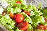 Stock Photo of Salad with cheery tomatoes and green leaves