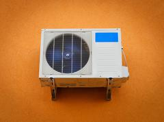 Modern air conditioner on wall Stock Photos