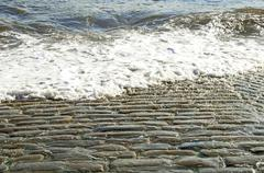 Old Cobbled Slipway Washed by Sea/Ocean - stock photo