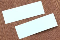 Rectangle of note paper stuck on dark wood. Stock Photos