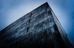 Abstract triangular building - stock photo