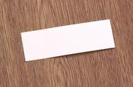 Stock Photo of rectangle of note paper stuck on dark wood.