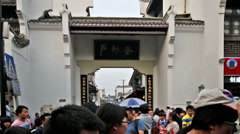 The crowded visitors wander Hubuxiang Snack Street in Wuhan, China Stock Footage