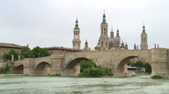 Basilica of El Pilar with stone bridge and large river Stock Footage