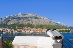 Binoculars and Makarska at Croatia Stock Photos