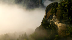 View into deep misty valley within marvellous sunrise in rocky park in Germany. Stock Footage